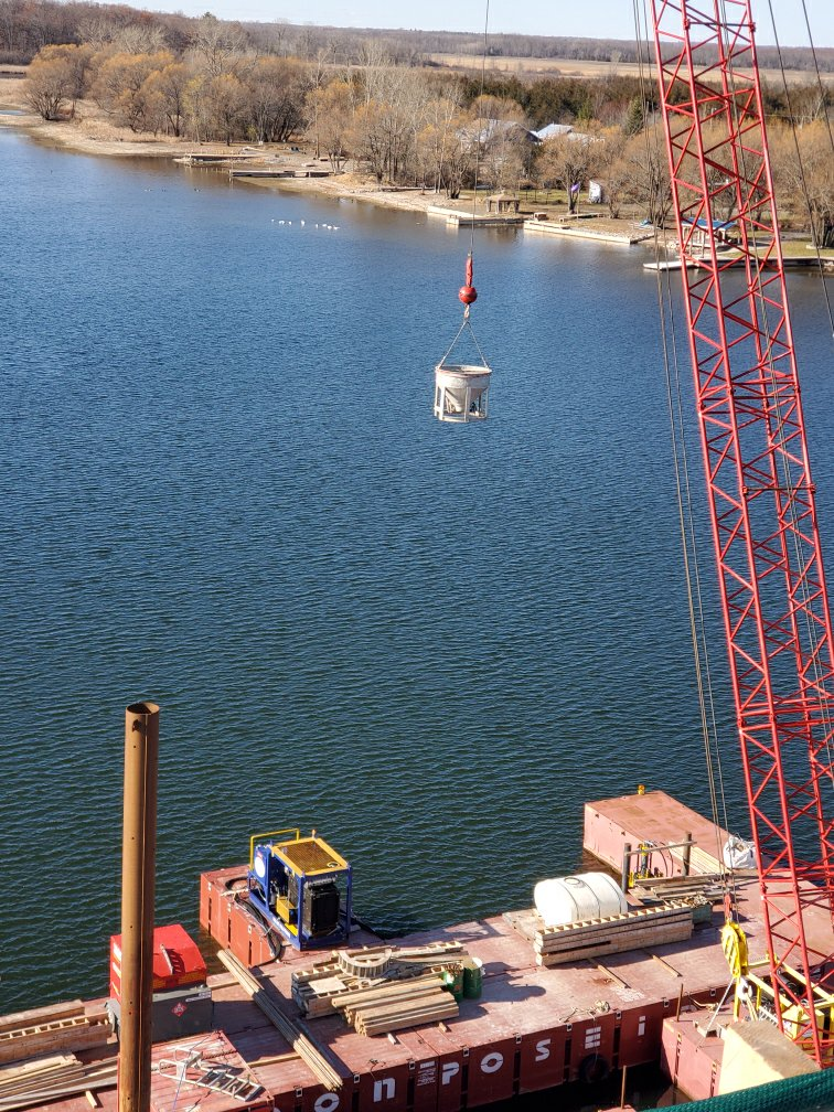 Lifting the concrete hopper from the barge to the deck