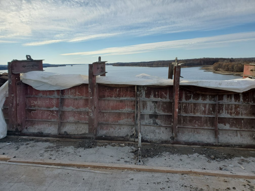 View west of barrier wall after concrete placement