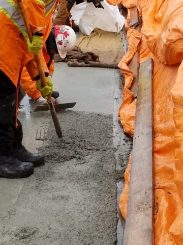 Finishing and troweling newly placed concrete