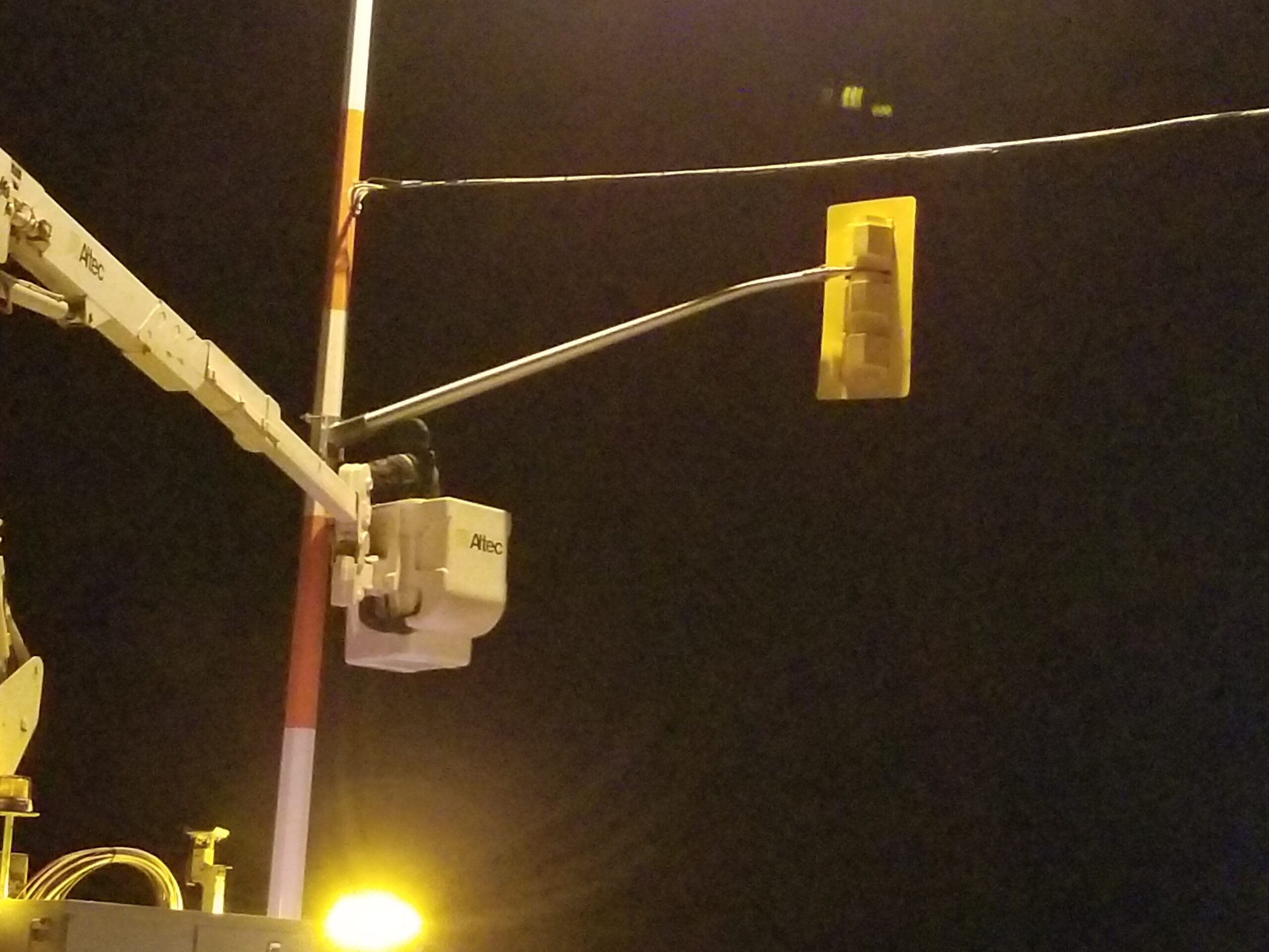 Disconnecting the traffic signal arm for removal