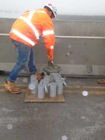 Filling the test cylinders with concrete