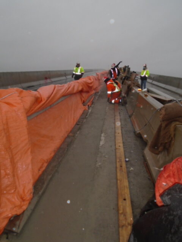 Newly placed concrete closure strip