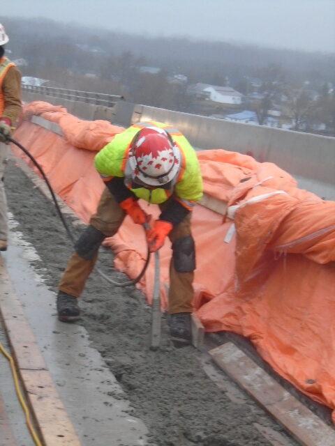 Vibrating the concrete in the closure strip