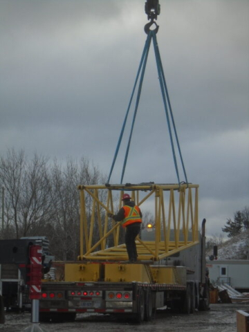 Section of boom being loaded on the truck