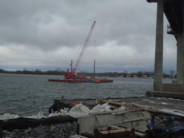Barge and 110 ton crane being brought to shore for the winter
