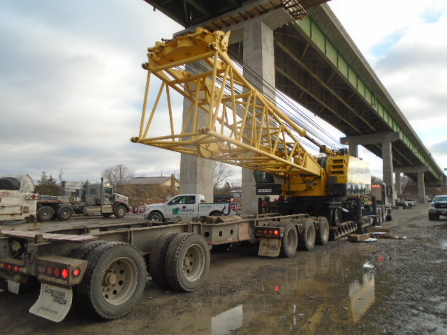Crane body being lowered onto the truck