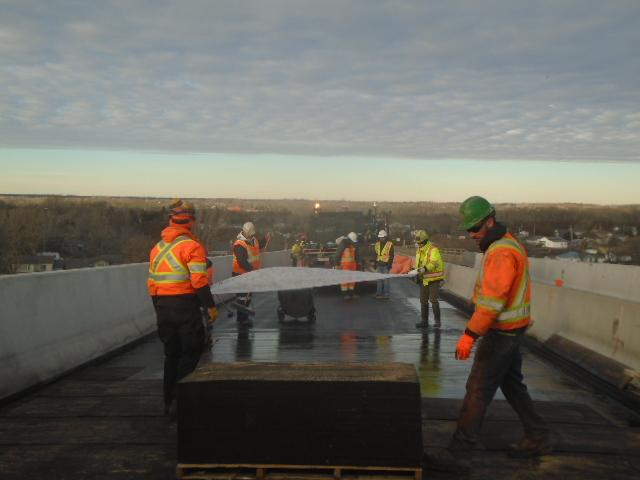 Placing membrane reinforcement during waterproofing operation