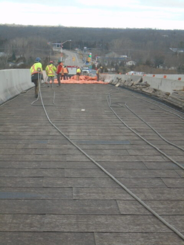 Placing the glycol lines to be used to heat the deck prior to asphalt placement