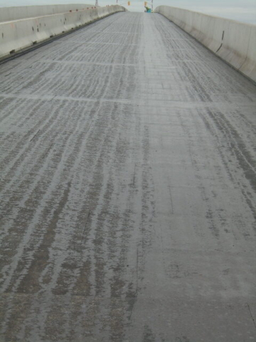 Completed tack coat over the protection board prior to asphalt paving