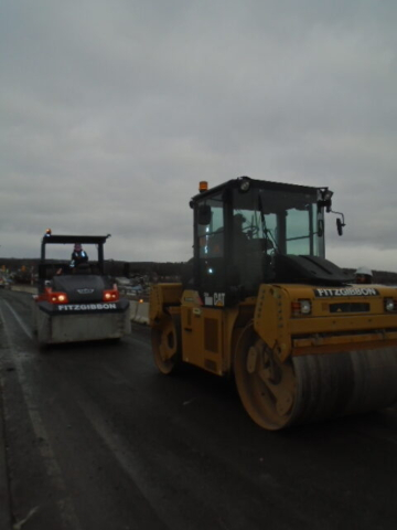 Steel drum roller and rubber tire rollers arriving on the deck for asphalt placement