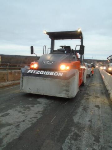 Rubber tire roller waiting to finish asphalt