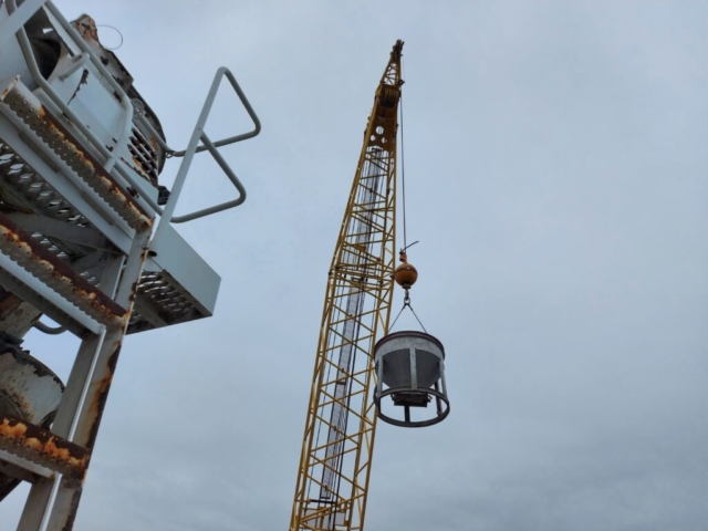 Hopper being lifted from the barge to the deck to the concrete truck