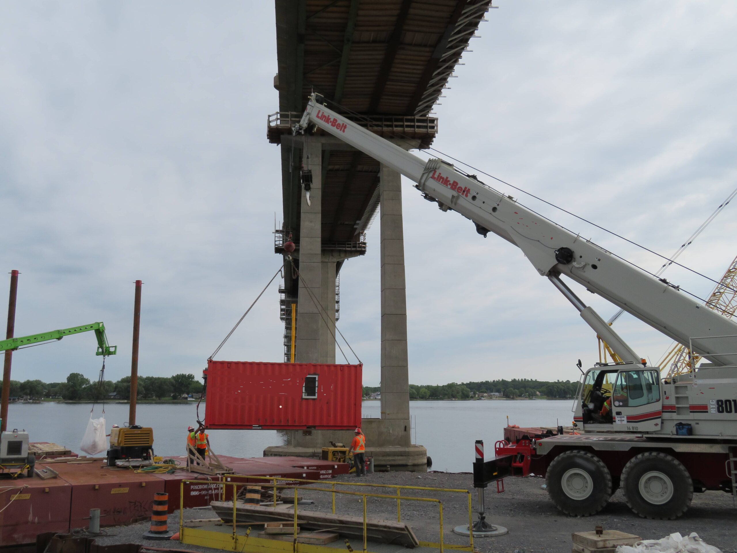 Loading the Sea-Can lunchroom on the barge with the telehandler
