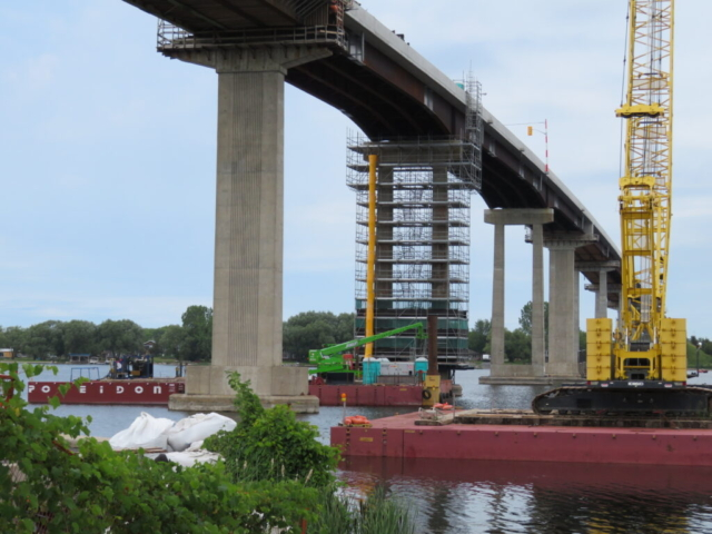 Overview of barges , 200-ton crane, man-lift at pier 10