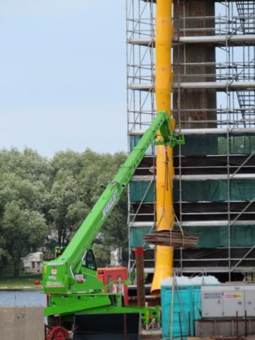 Man-lift moving materials on pier 10