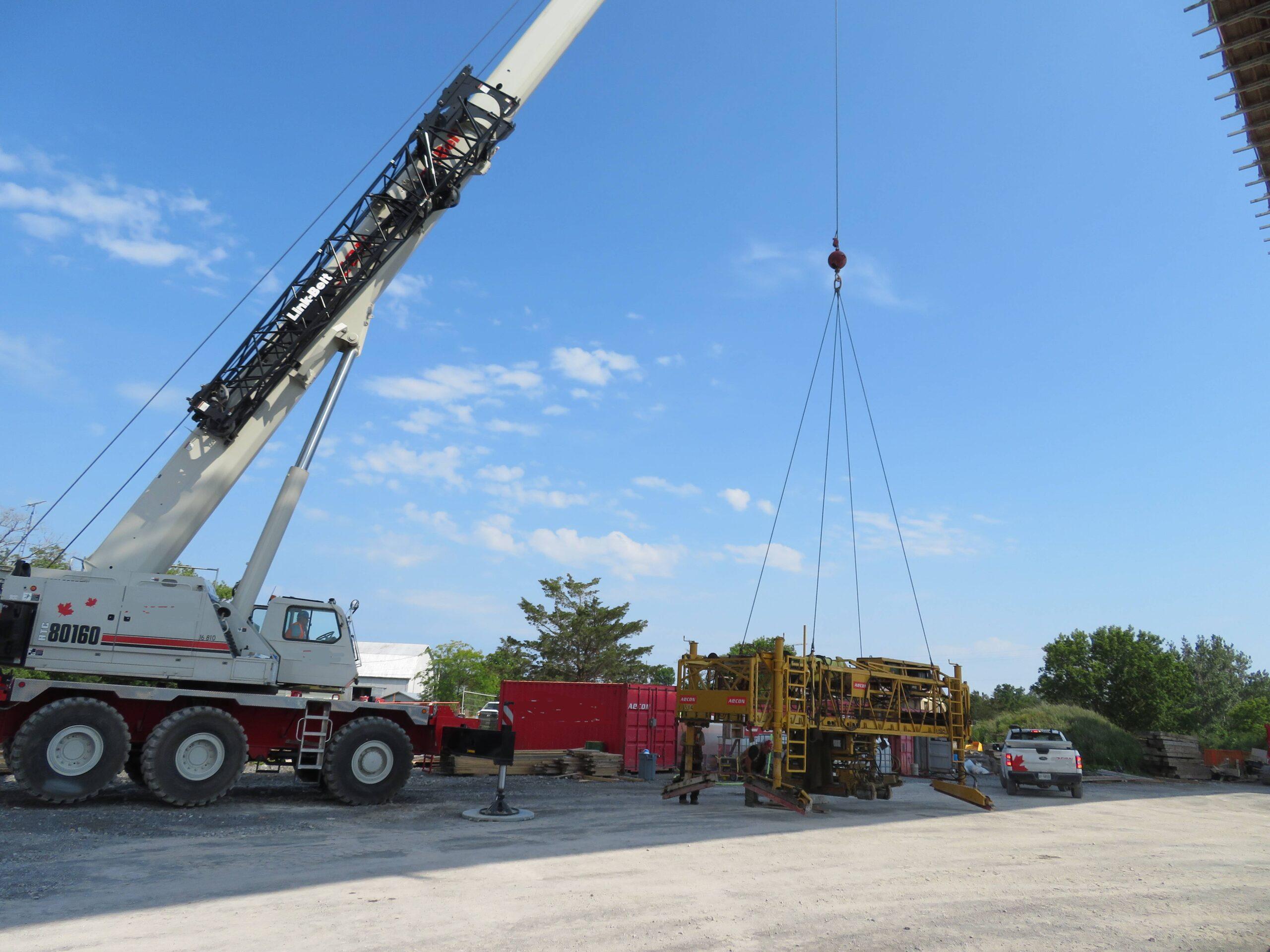 160-ton crane moving the concrete finisher