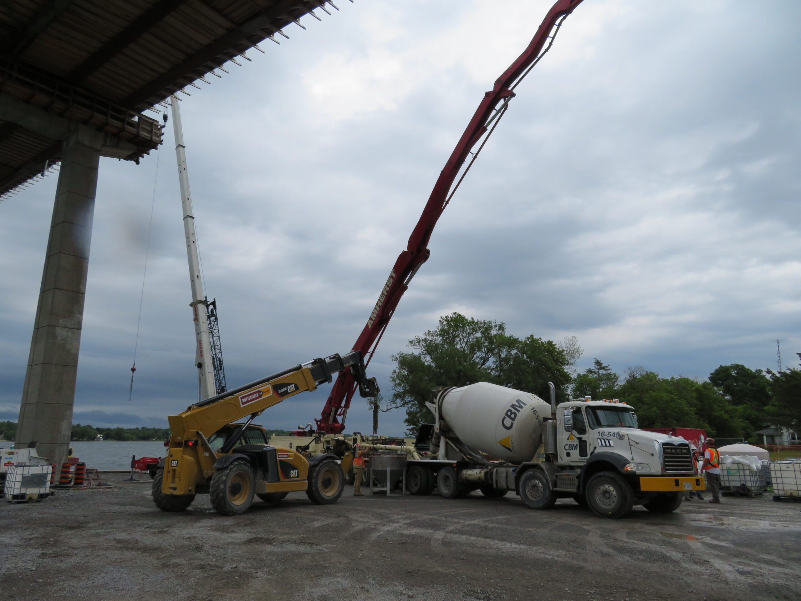 Overview, concrete pump, concrete truck and telehandler and hopper