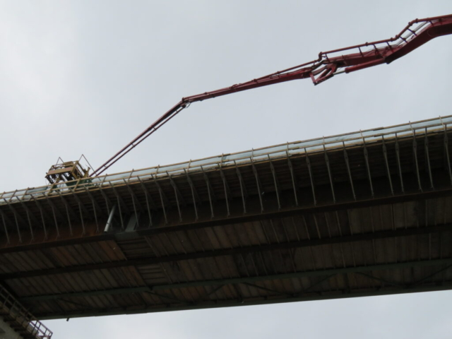 View from below of the concrete pump lifted to the  bridge deck