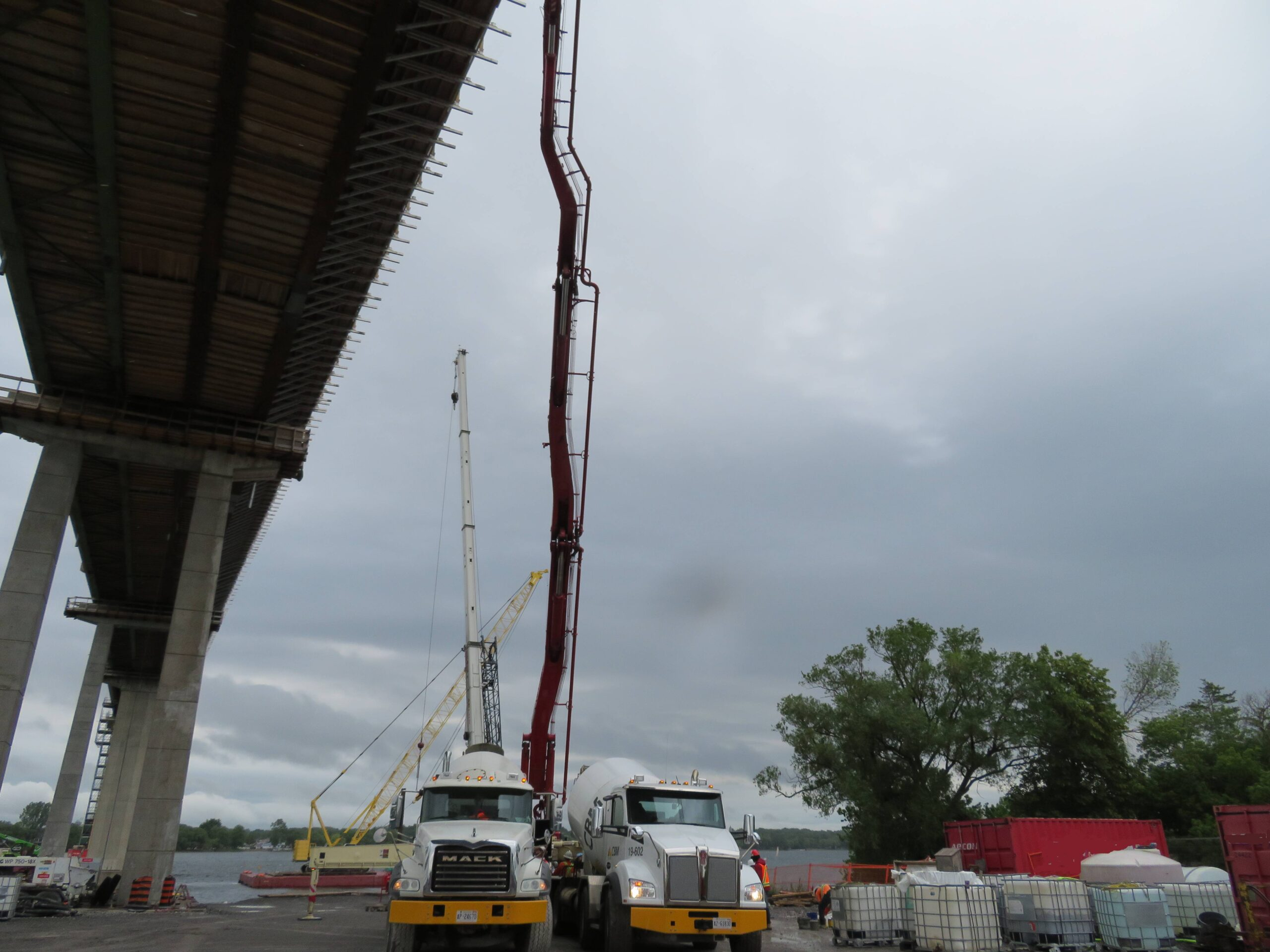 Overview from below of the bridge, concrete trucks and pump