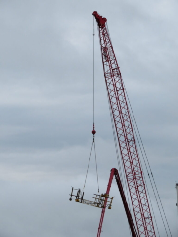 Lifting the work bridge to the deck with the 110-ton crane