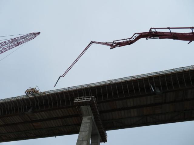 Lifting the concrete pump to the bridge deck in preparation for concrete placement