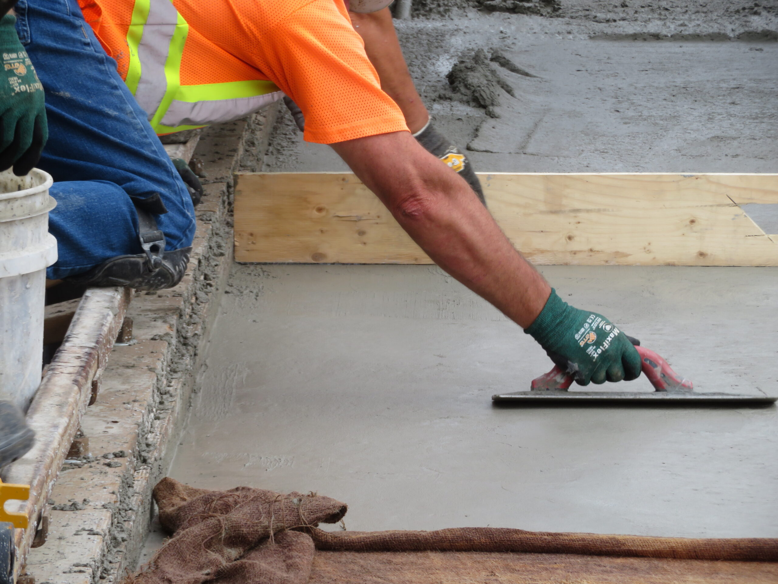 Finishing the newly placed concrete