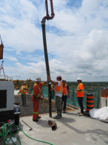 Installing a pipe on the concrete pump for concrete placement