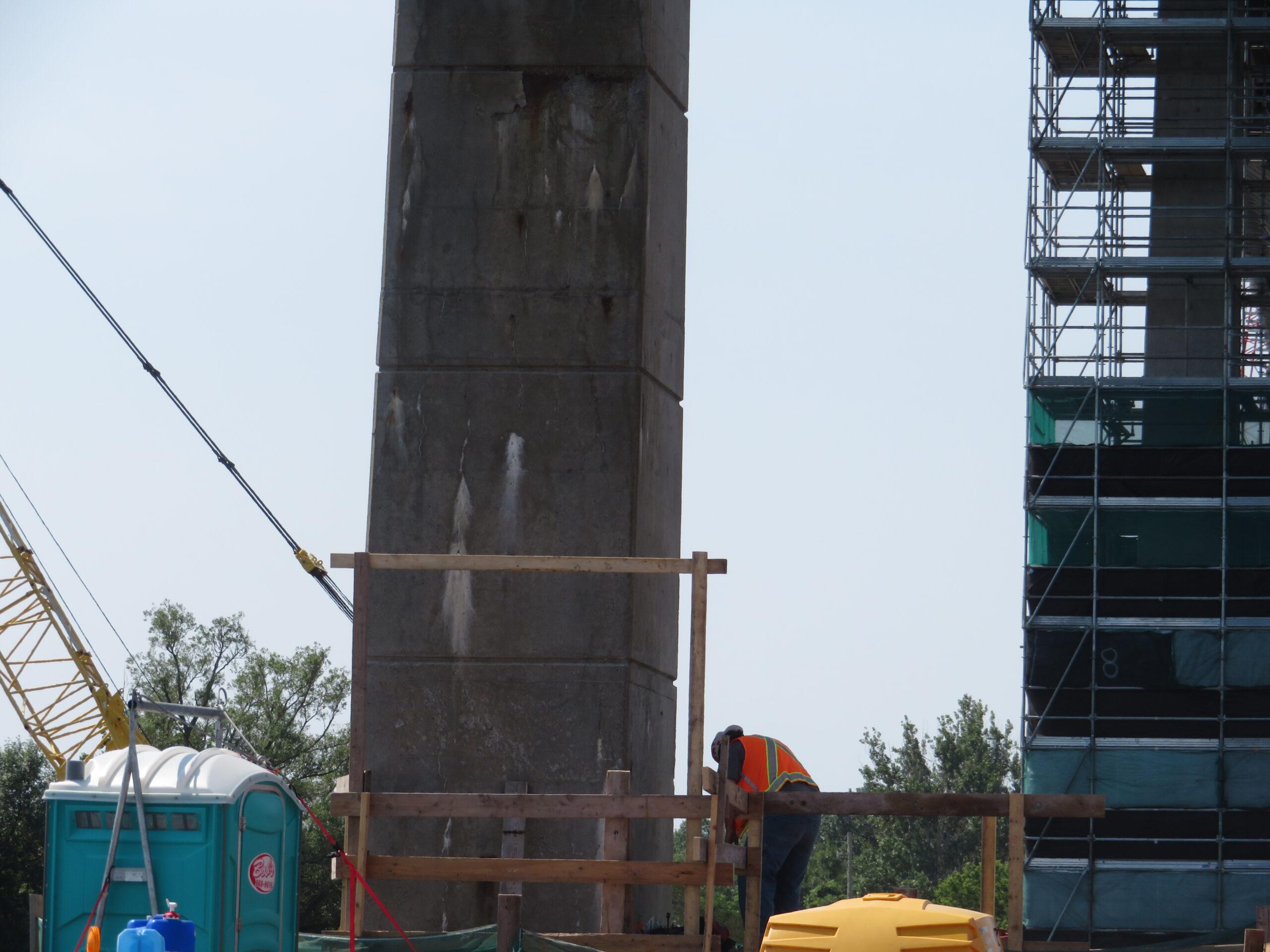 Building work platform on pier base 9