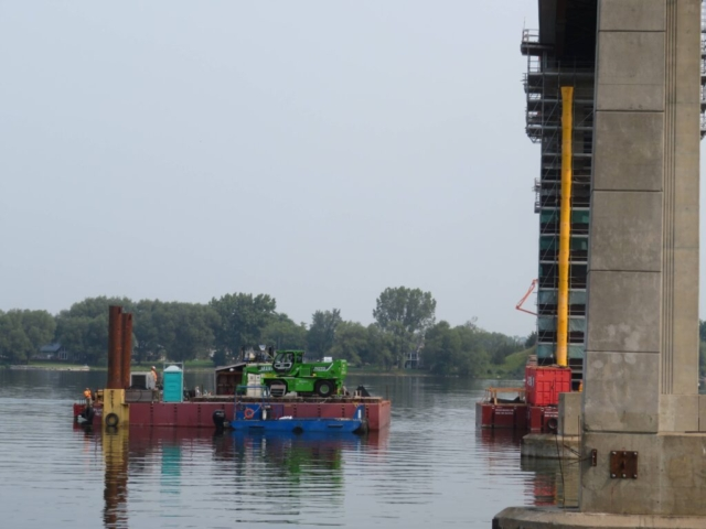 Moving the manlift barge  into place near pier 10