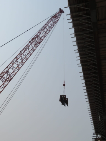 110-ton crane lifting the barrier wall formwork to the bridge deck