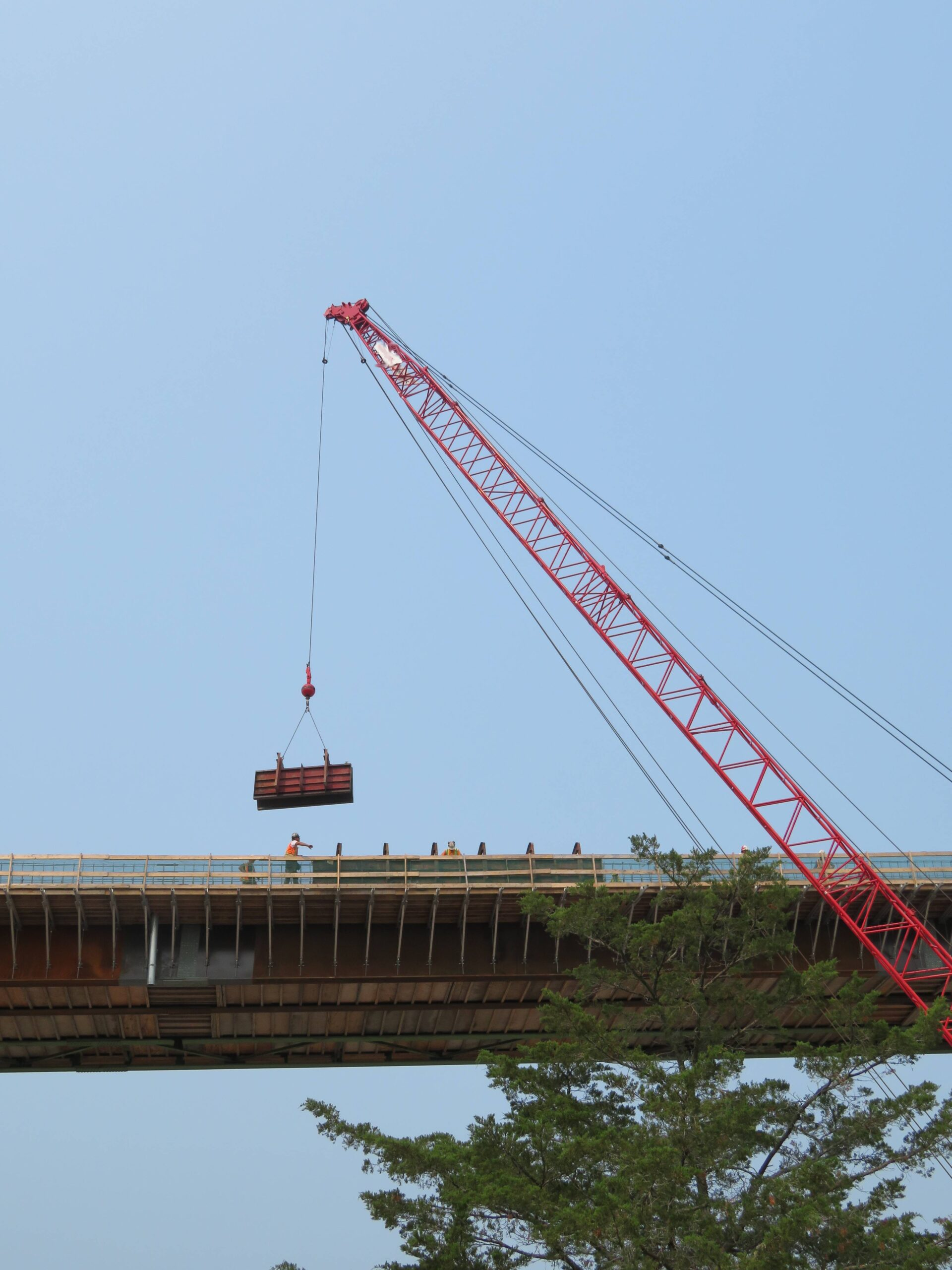 View from below of barrier wall formwork being lowered into place