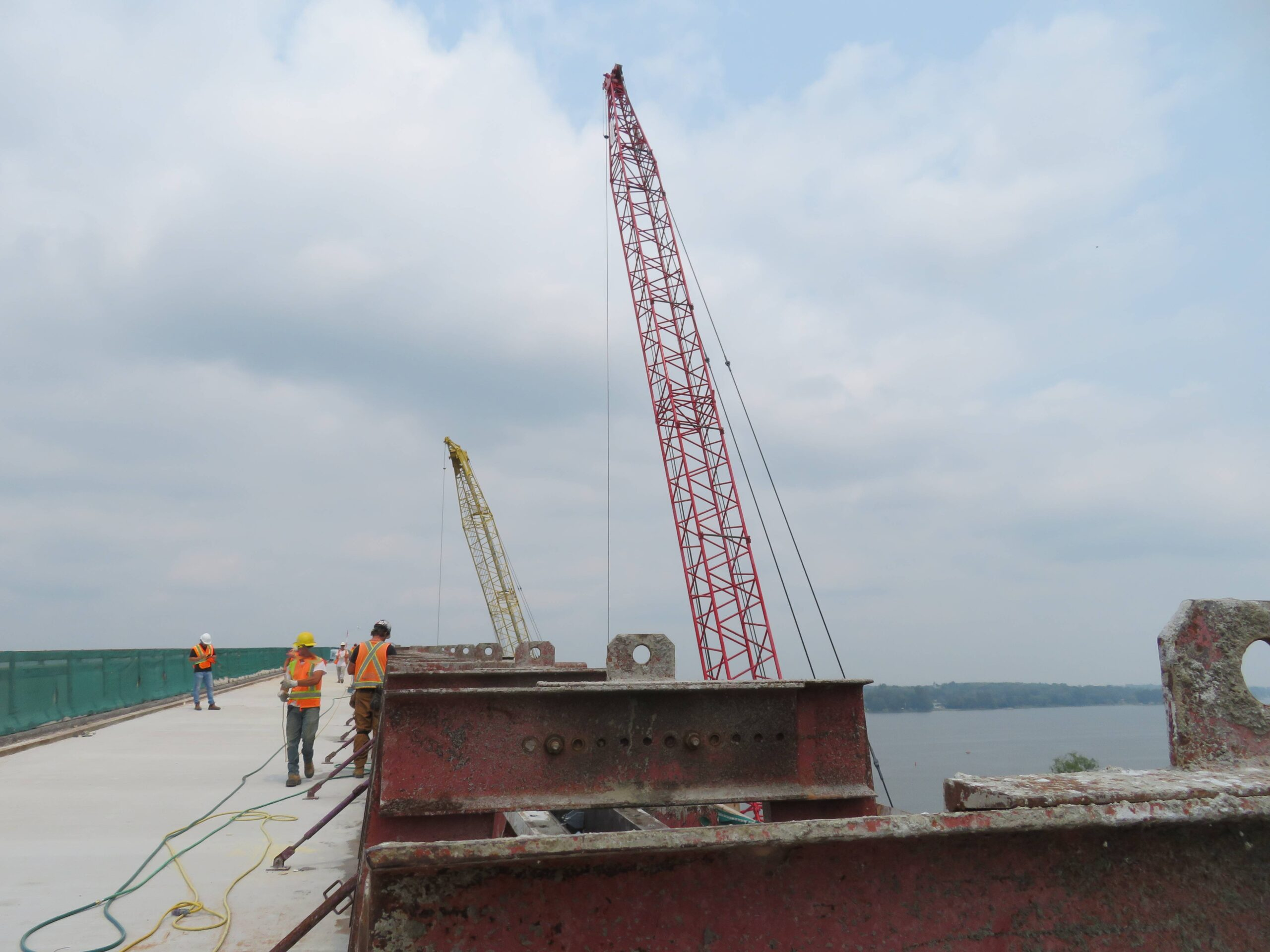 Barrier wall forms in place , both 110 and 200-ton cranes