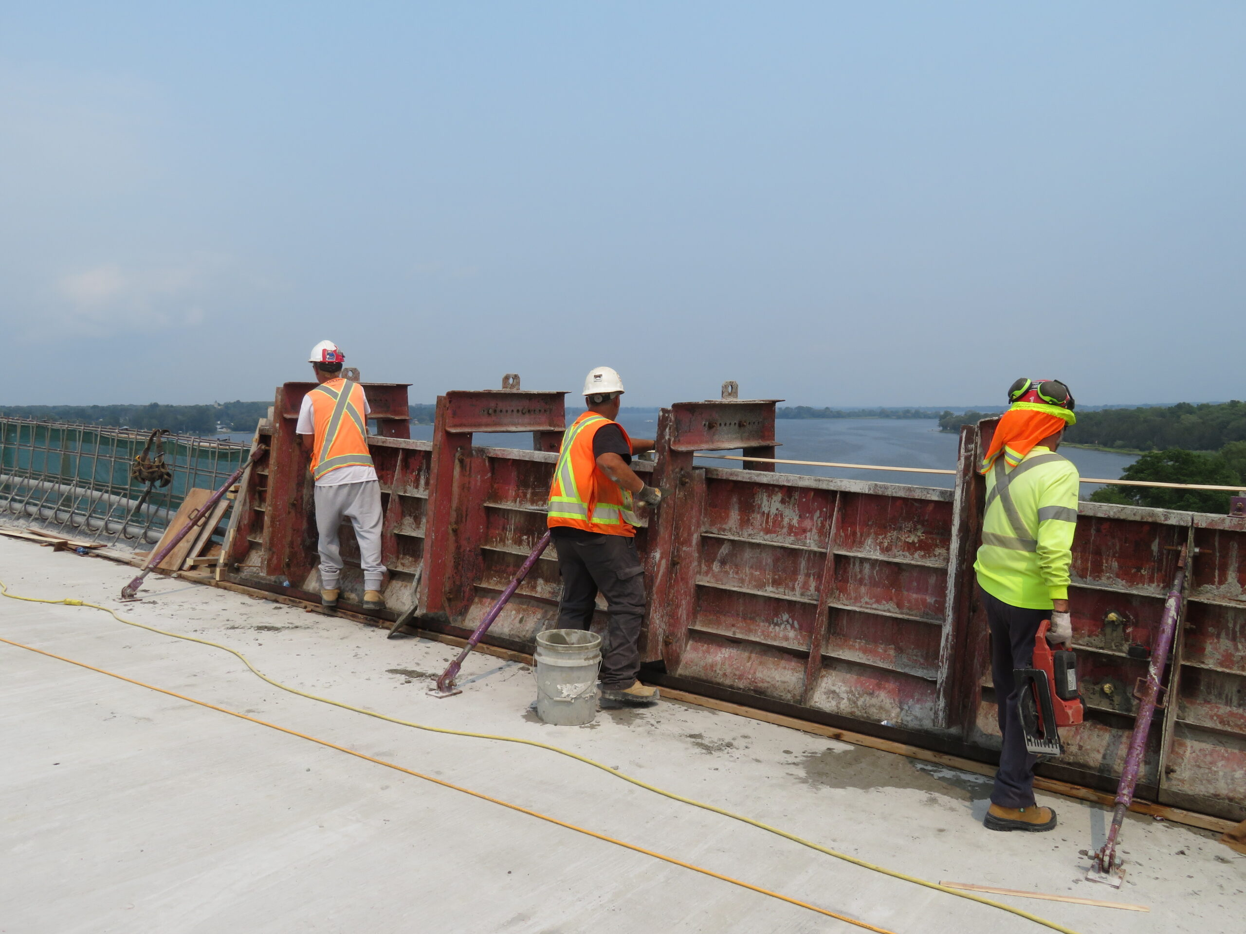 Placing the chamfer on the edges of the newly placed concrete