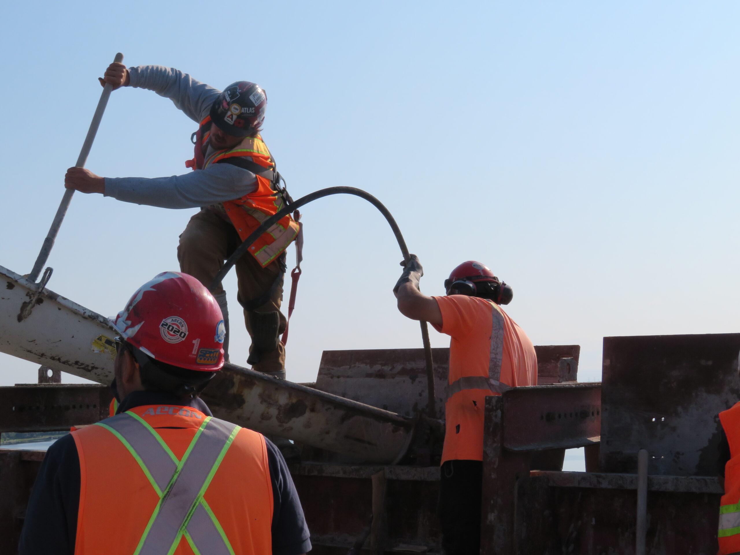Filling the concrete forms, vibrating the concrete