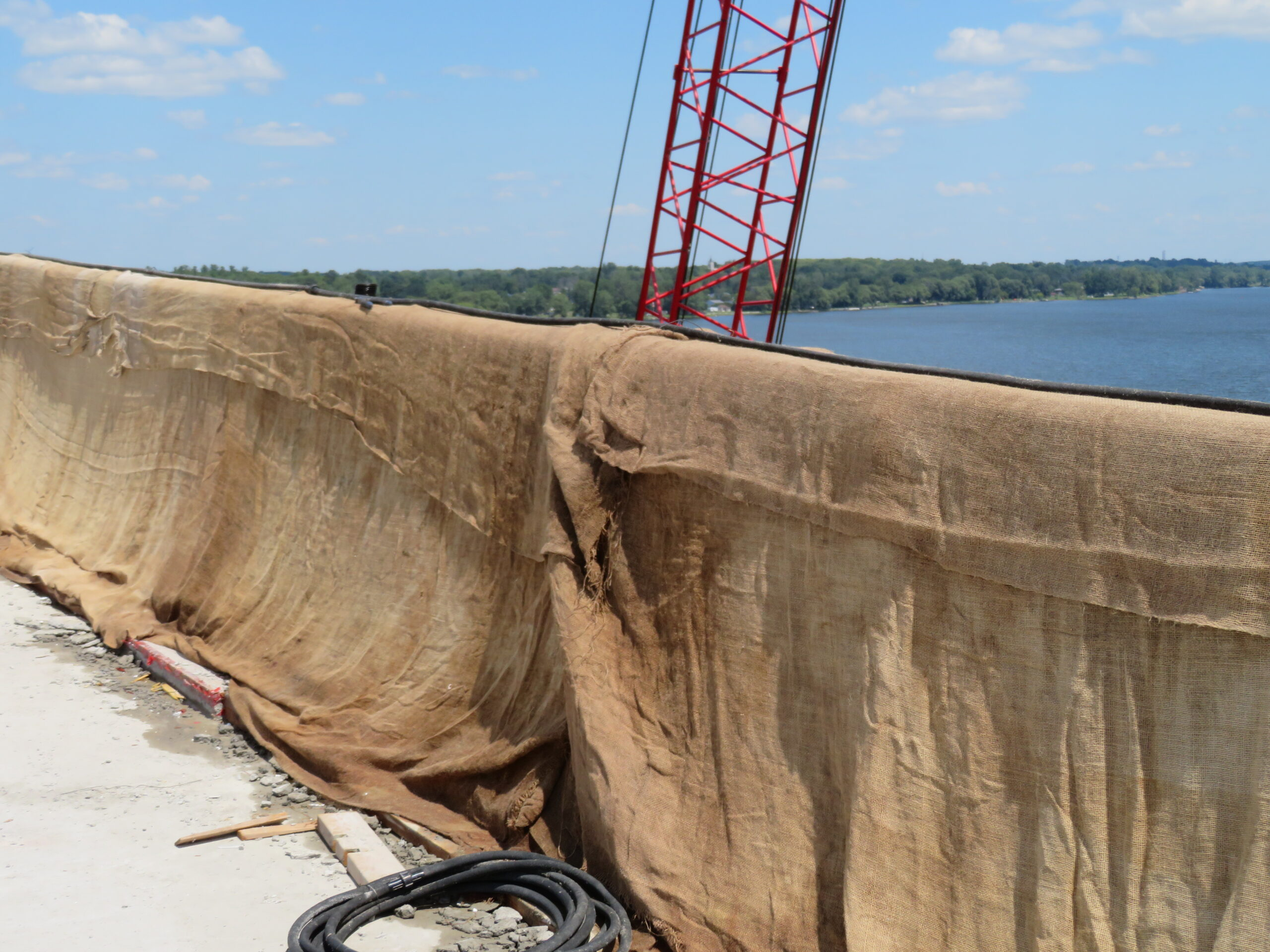 Wet burlap covering new barrier wall section