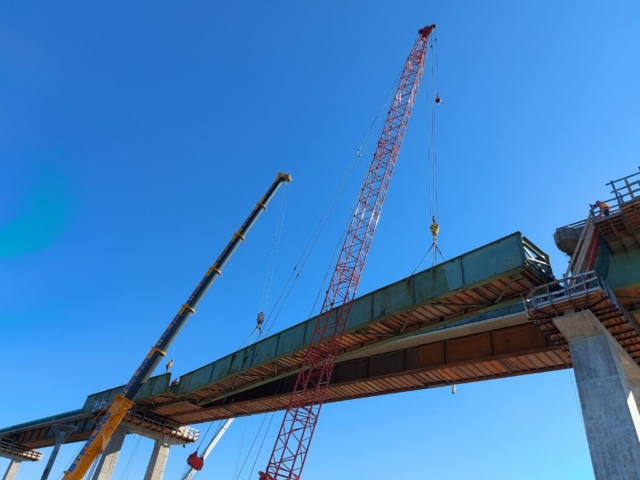 Starting to lower the second approach girder