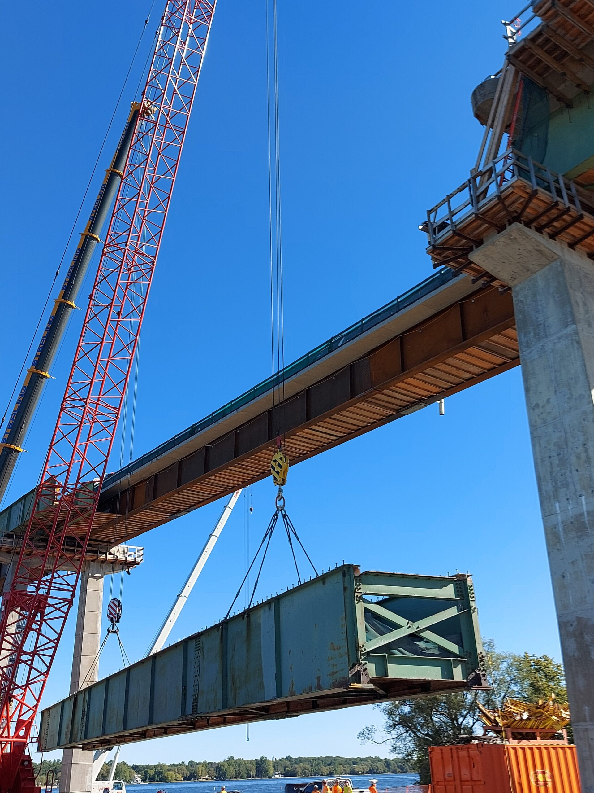 Approach girder being lowered to the ground