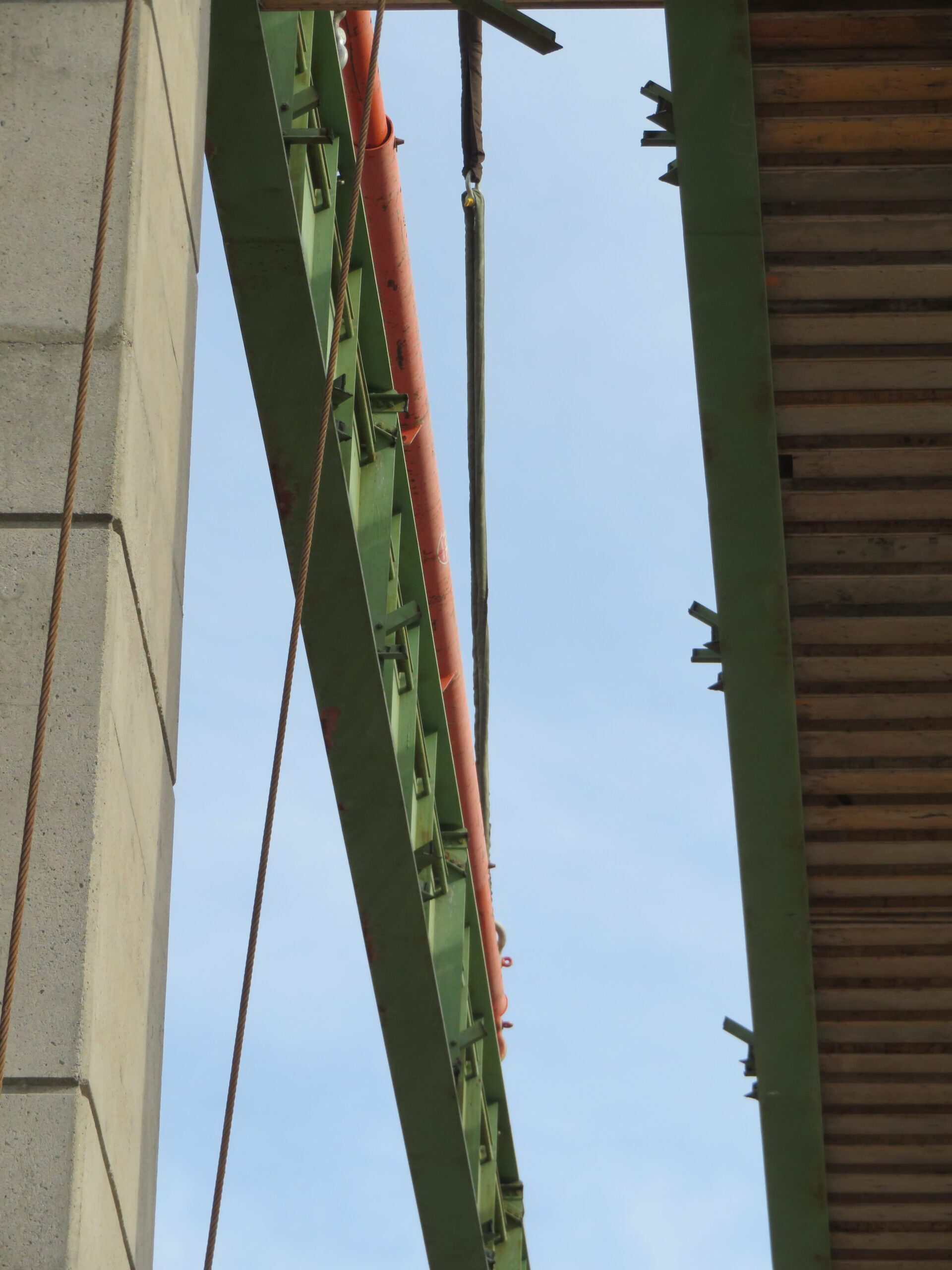 View between the girders of the spreader bar hooked up to the girder