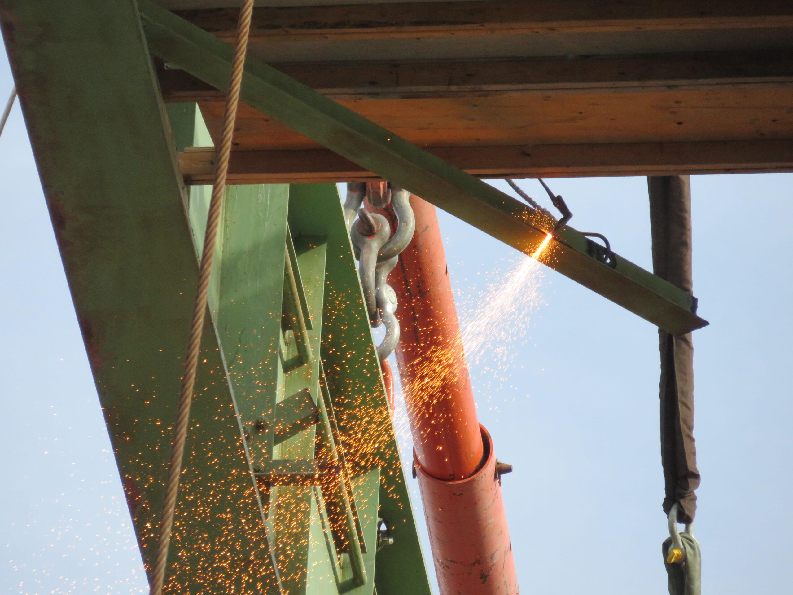 Close-up cutting the girder bracing