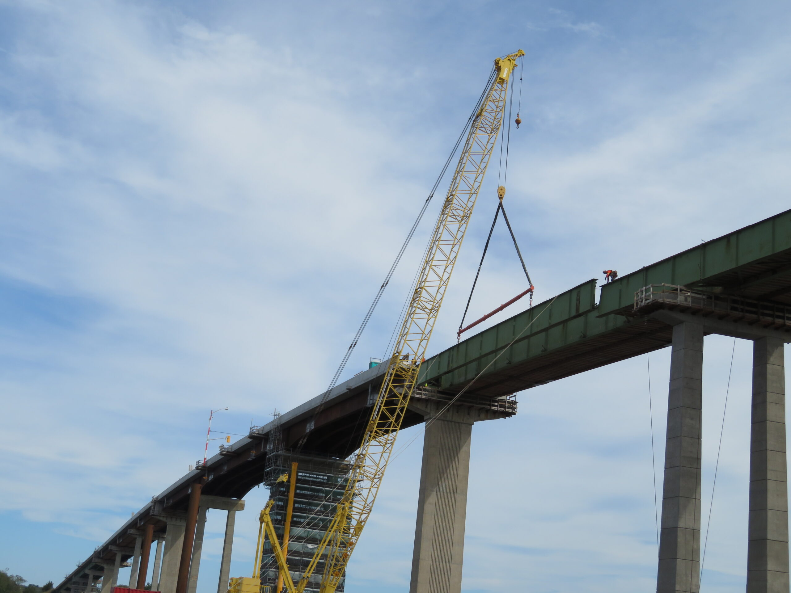 Starting to lower the first section of girder