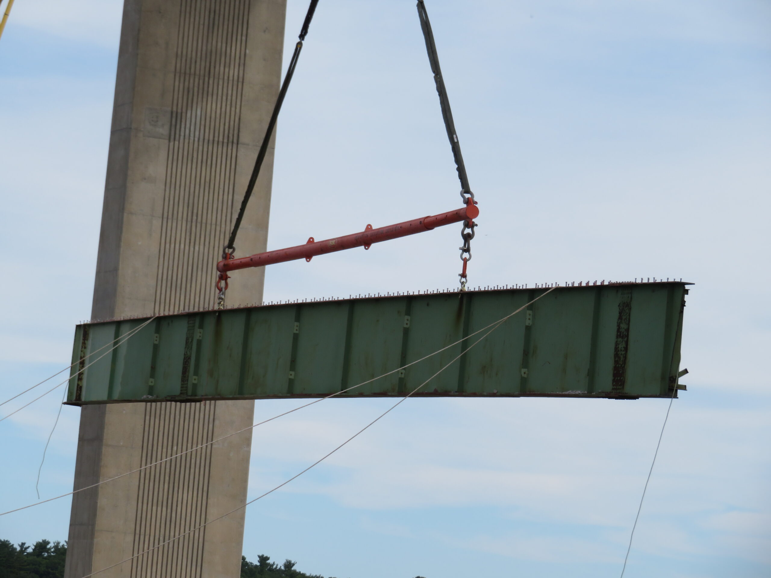 Close-up, girder section being lowered