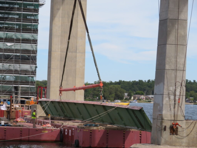 Laying the girder section down on the barge