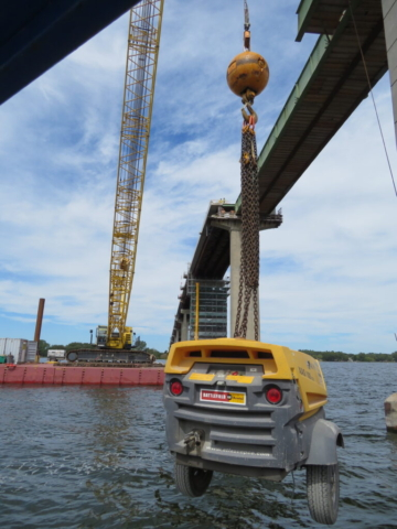 Using the 200-ton crane to move the generator from the dock to the bridge deck