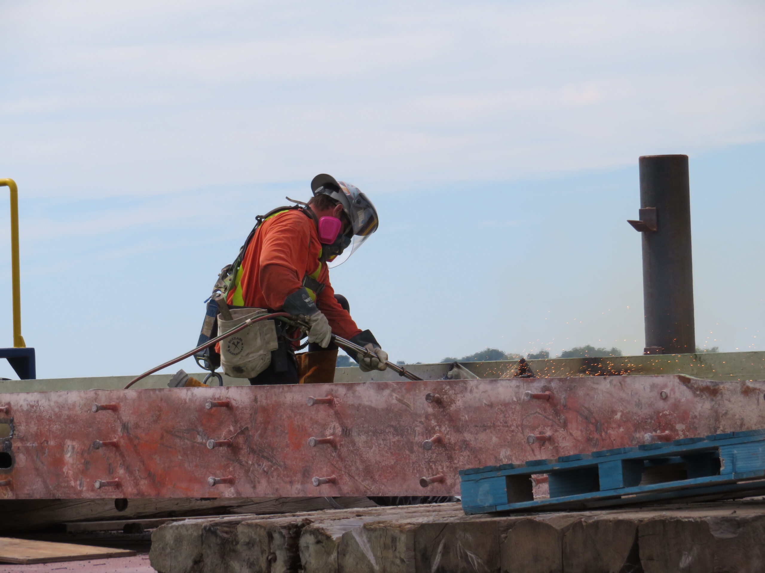 Torch cutting the removed girder