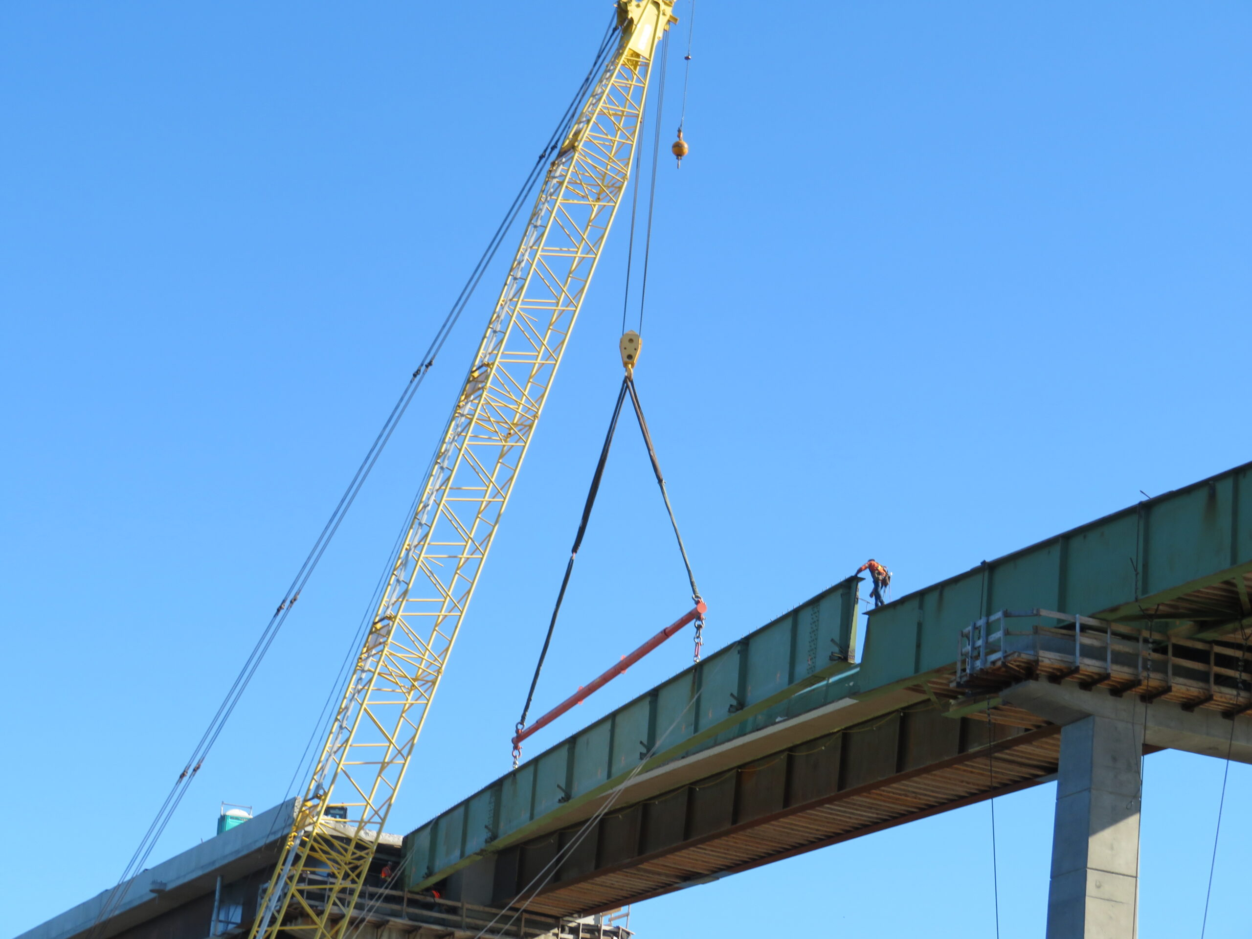 Preparing to lower the removed girder section