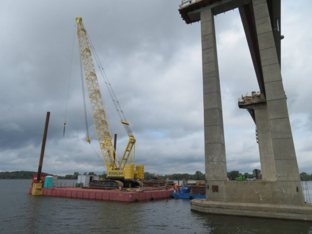 Repositioning the barge / 200-ton crane