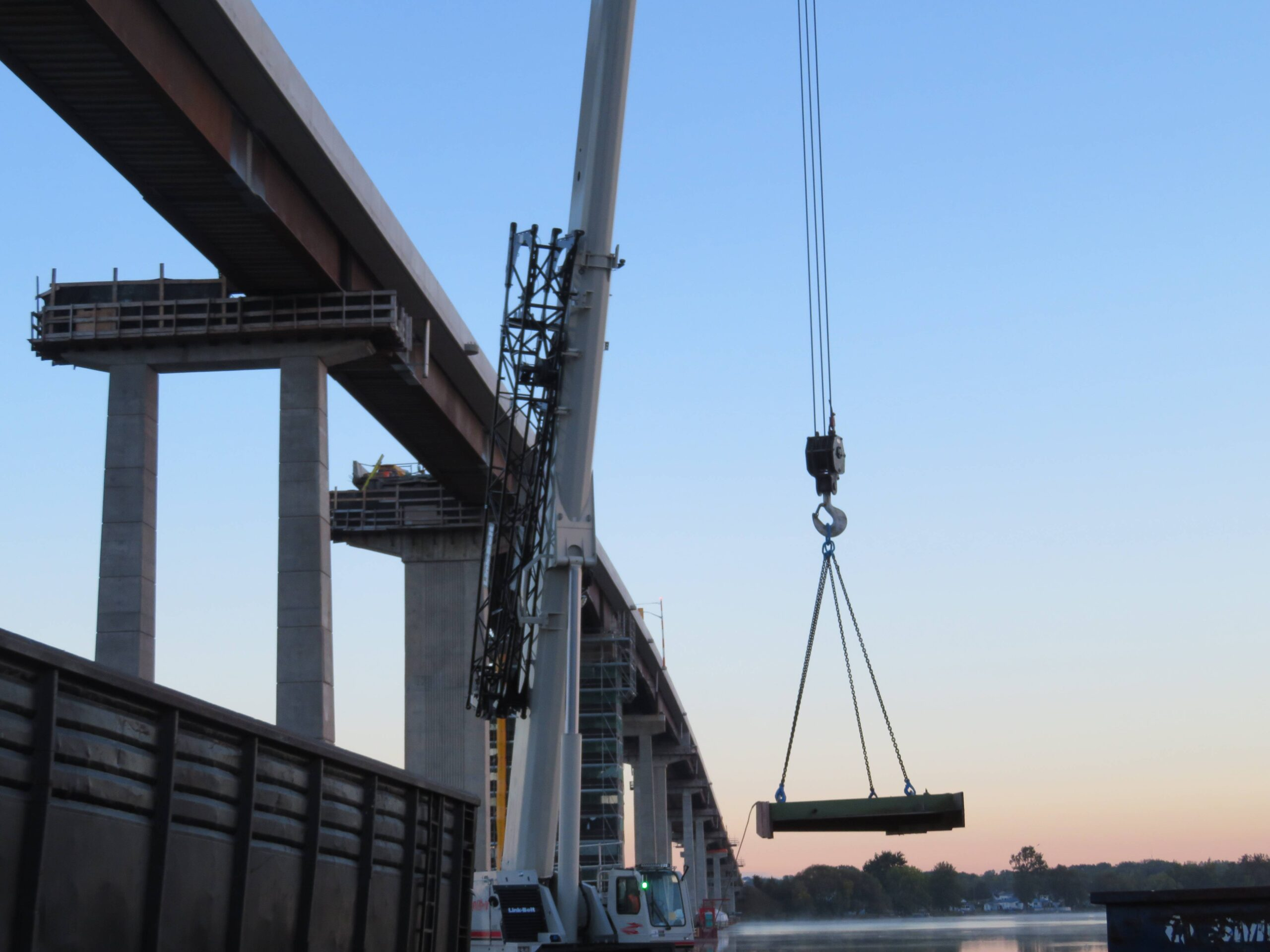 Using the 160-ton crane to load the truck with removed girder pieces
