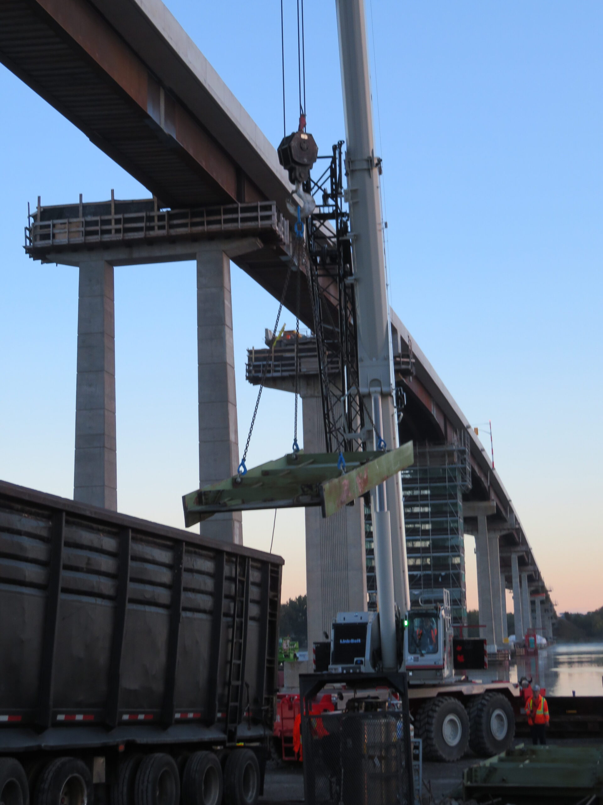 Loading removed girder pieces onto the truck