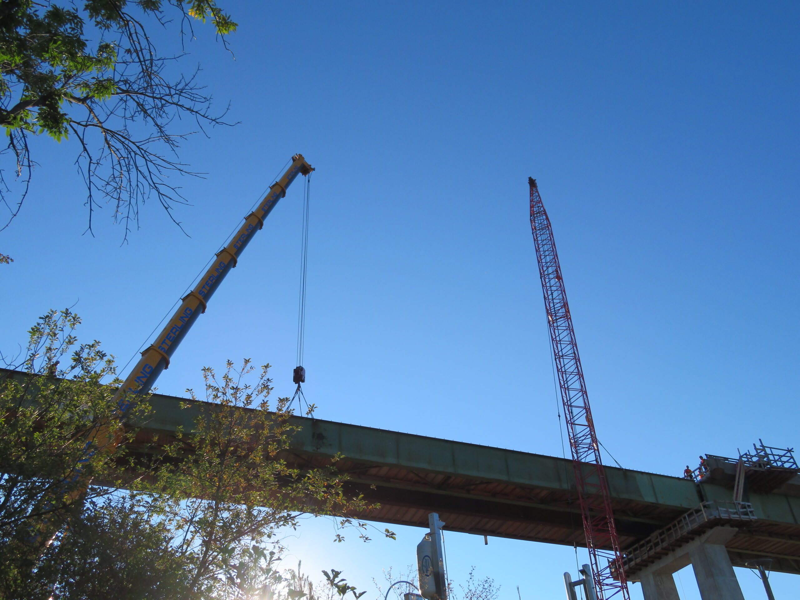 110 and 300-ton cranes preparing to remove the second approach girder