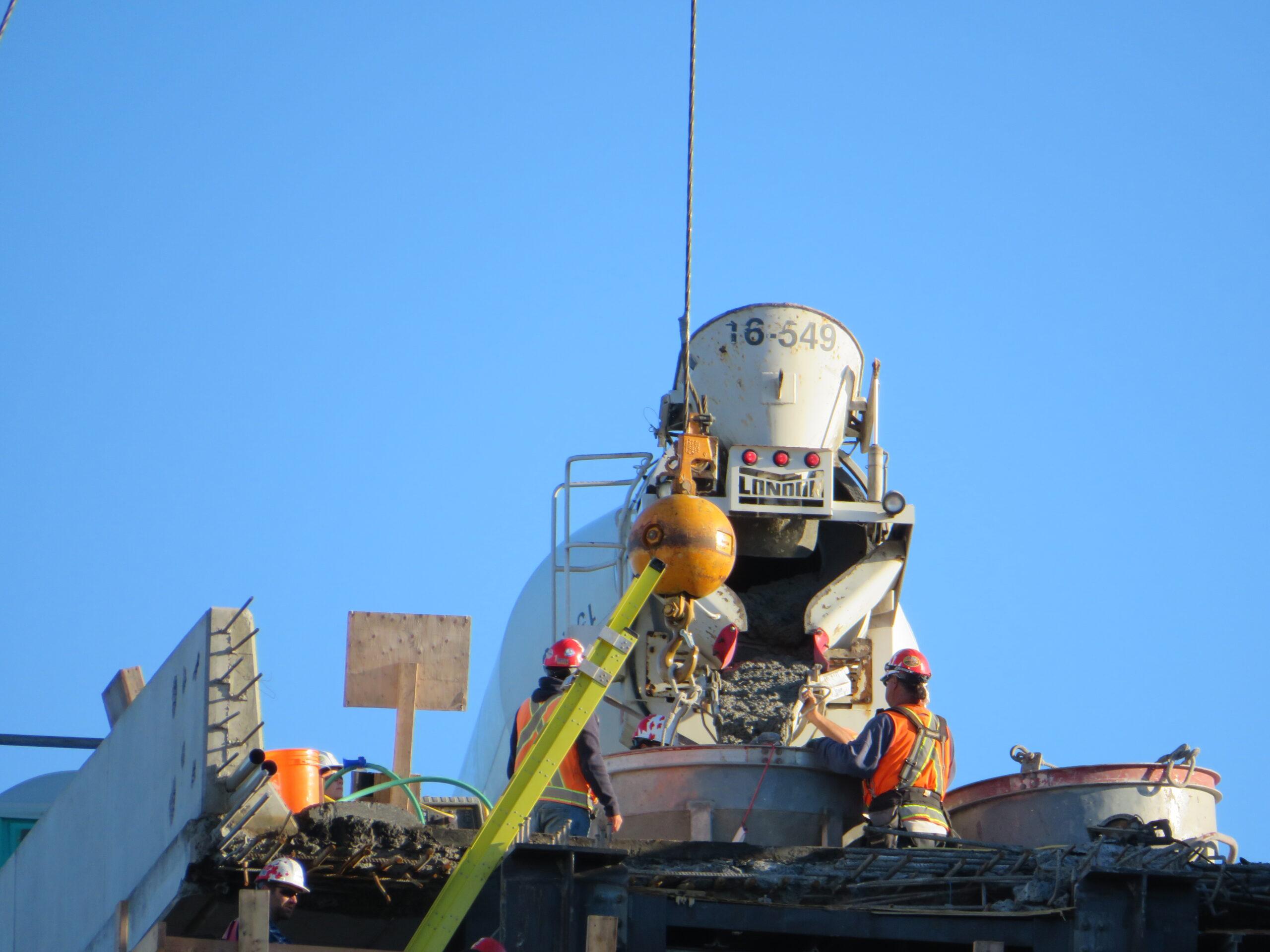 Filling the hopper for concrete placement on pier cap 12